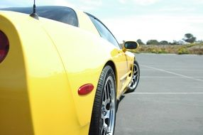 side of a yellow sports car