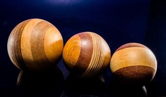 three handmade wooden balls
