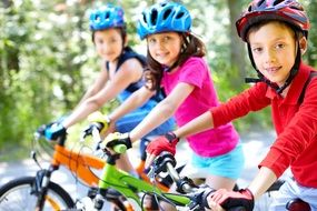 children ride bicycles
