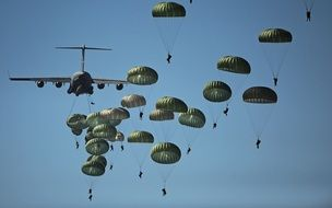 View from below on military paratroopers