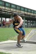 shot putter, male athlete throwing ball
