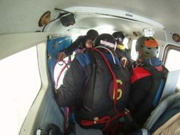 men are preparing for a parachute jump