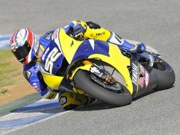 motorcycle racer on a yellow-blue motorcycle