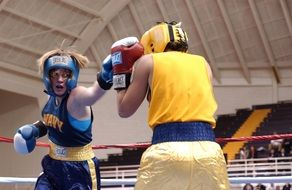 female boxers boxing on ring