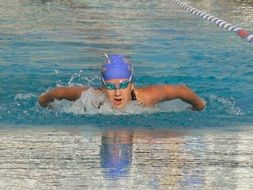 swimmer in blue swimming cap in the pool