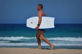 a man with a surfboard