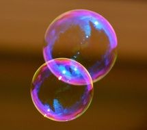 two colorful soap bubble together