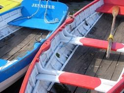 colorful canoes side by side