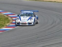 white racing car on the track