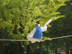 sitting korean dancer on a rope