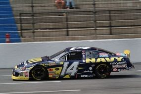 navy racing car on track