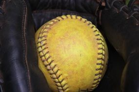 ball in glove for softball