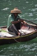 a man in a boat fishing