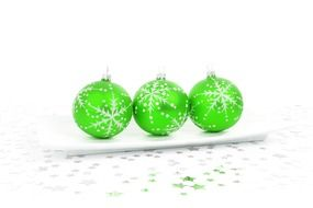 Three green Christmas balls