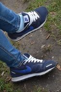 blue nike sneakers on the feet