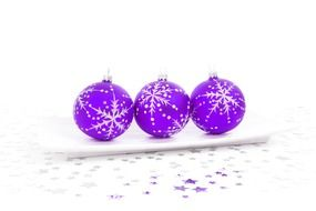 purple christmas balls on white surface