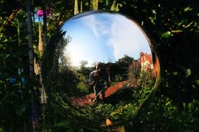 mirroring ball in a garden