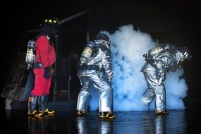 firefighters near the smoke at night