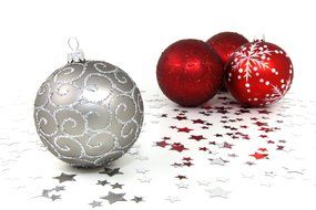 one silver and three red Christmas balls