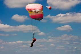 Side view of a parachute jump
