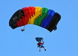 parachutist with multi-colored parachute