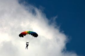 skydiver on a white cloud background