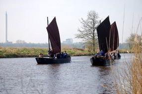three sailing boats on the river