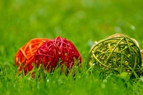 decorative balls on green grass