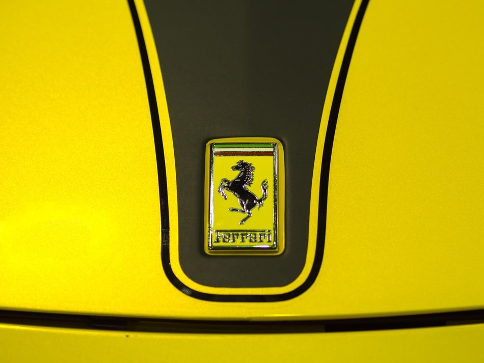 Ferrari sign on the hood of a car
