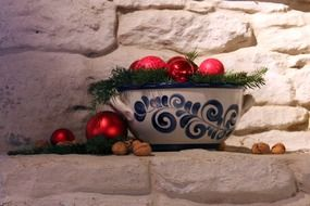 ceramic bowl with red christmas balls