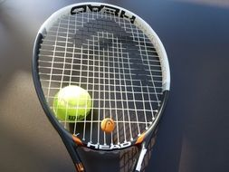 tennis racket and yellow ball
