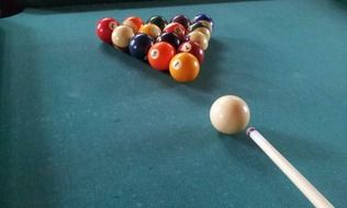 breaking balls on a pool table