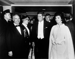 president john f kennedy with wife walking on inaugural ball