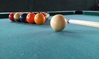 multi-colored balls on a table in billiards