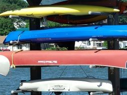 stacked colorful kayaks
