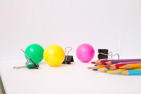 multicolored balls and stationery on the table