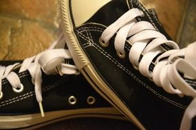 Pair of athletic shoes with white laces