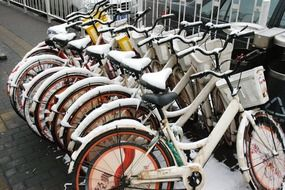 bicycles in the parking lot in the snow