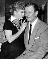 black and white portrait of Lucille Ball and John Wayne