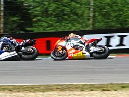 Marco Melandry and Max Biaggi on the race track