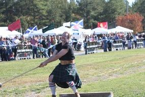 power throw in traditional Scottish clothing