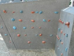 climbing wall sport with colorful holds
