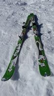 green skis on the snow