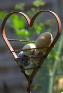 metal figure of a heart and eggs