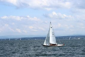ship with white sails on Lake Constance