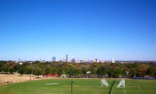 soccer field in front of city skyline, usa, texas, austin