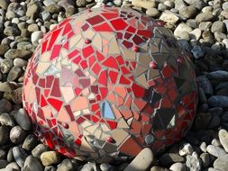 colored ceramic ball on pebbles