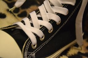 Sports shoes with white laces close-up