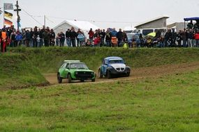 autocross cars in the mud