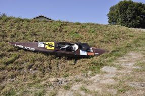 kayak laying on hill side